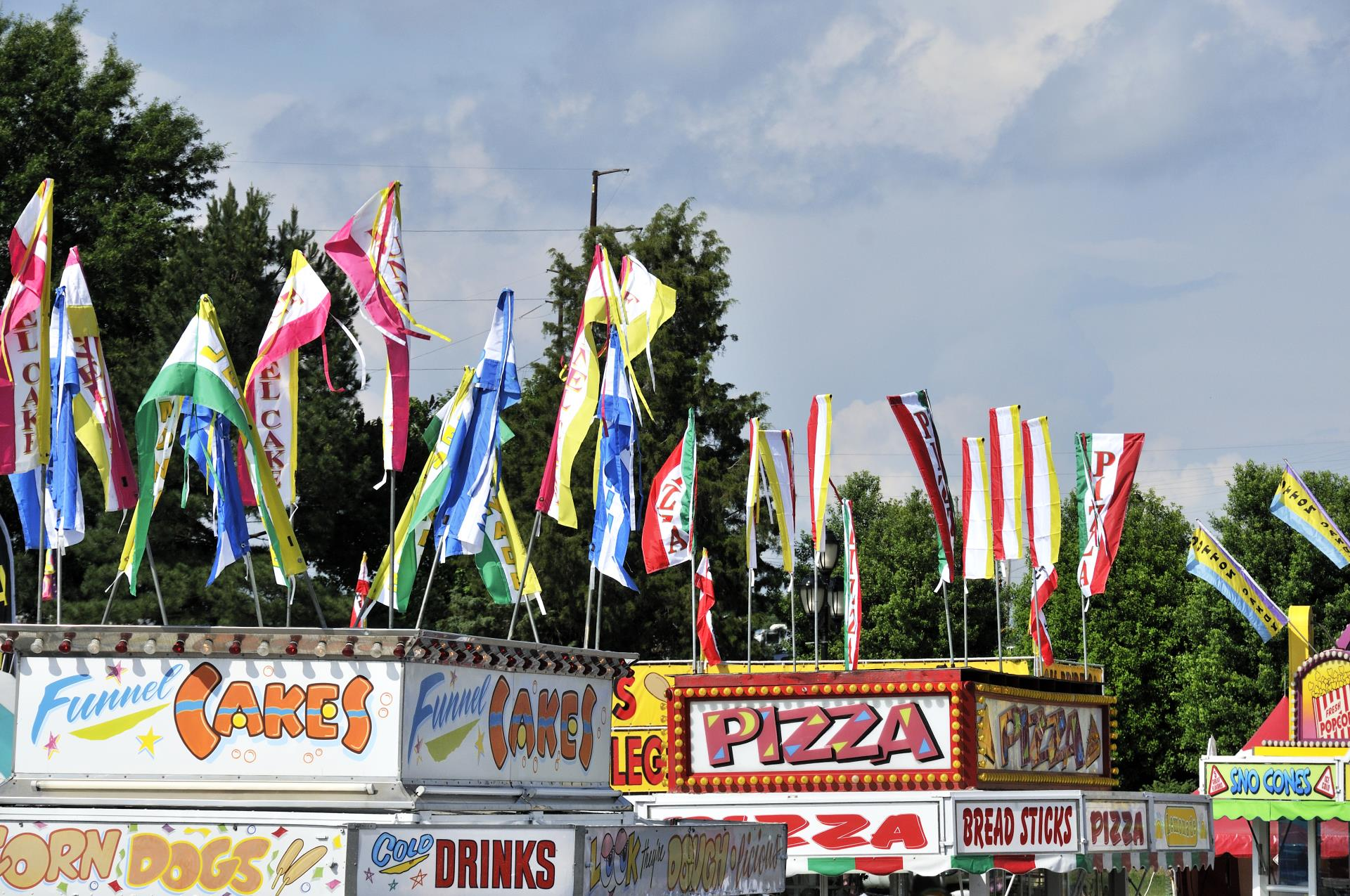 flags on top of fair vendors with food